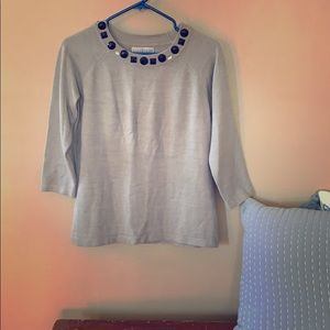Gray sweater with black neckline embellishments